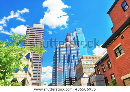 Bottom up view to skyscrapers mirrored in glass in Philadelphia, Pennsylvania, USA. It is central business district in Philadelphia - stock photo