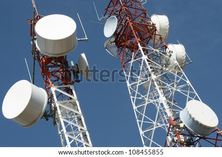 bottom view of  a telecommunications towers with a clear blue sky, La Muela, Saragosa, Aragon, Spain - stock photo