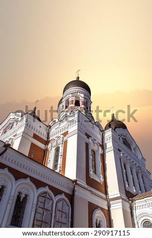 Bottom view of Alexander Nevsky Cathedral in Tallinn, Estonia, on sunrise or sunset background. - stock photo