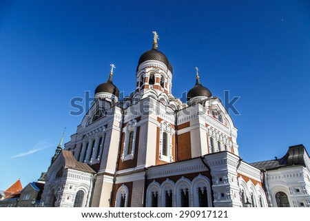 Bottom view of Alexander Nevsky Cathedral which is the grandest orthodoxy cathedral in Tallinn Estonia, on navy blue background. - stock photo