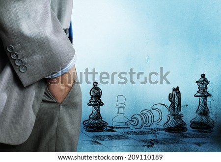 Bottom view of businessman and chess game at background - stock photo
