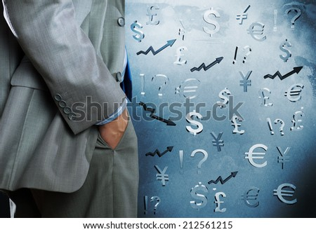 Bottom view of businessman and currency signs at background - stock photo