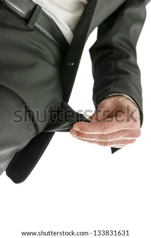 Bottom view of businessman hand showing empty pocket explaining he has no money.