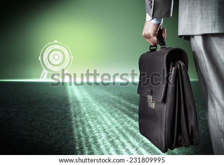 Bottom view of businessman with suitcase in hand - stock photo
