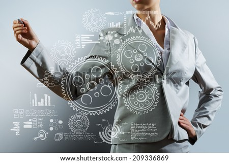 Bottom view of businesswoman drawing business sketches - stock photo