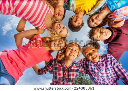 Bottom view of kids group standing in round shape - stock photo