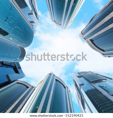 Bottom view of modern skyscraper. Business district - stock photo
