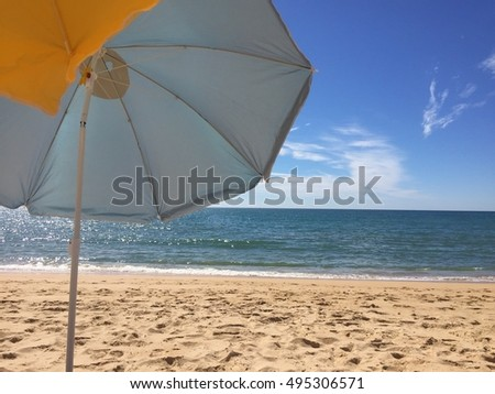 Bottom view of sun parasol protection blue sky outdoors background