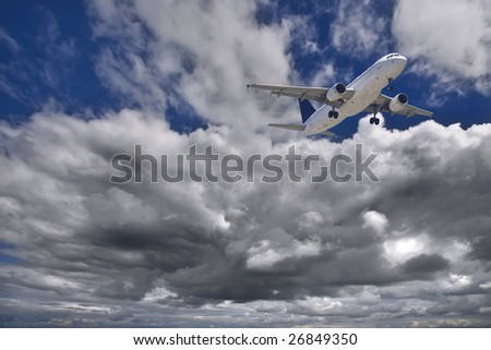 Bottom View of the moment of landing a plane with clouds background - stock photo