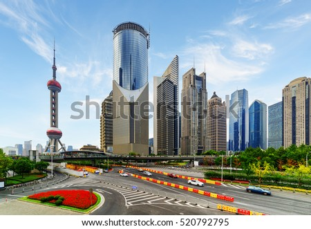Bottom view of the Pudong New District of Shanghai, China. Skyscrapers of downtown on cloudy sky background.