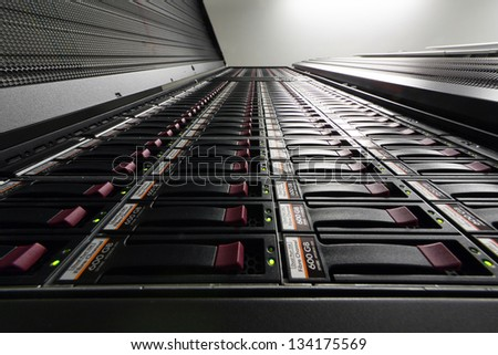 Bottom view on big rack with multiple hard drives. - stock photo