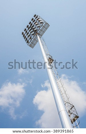 bottom view,Stadium of  light  tower in blue sky - stock photo