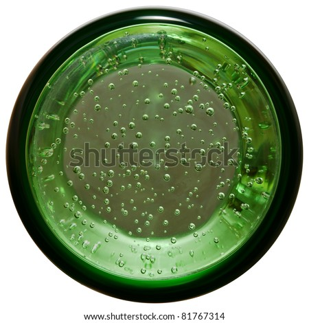 Bottom view to full glass of mineral water - stock photo