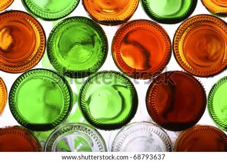 Bottoms of empty glass bottles on white - stock photo