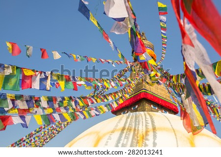 Boudhanath stupa - symbol of Nepal, with colorful prayer flags. - stock photo