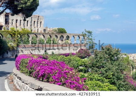 Bougainvillea flowers and ancient architecture in Taormina at the Siclilian Island, Italy