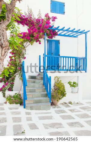 Bougainvillea flowers around the house with a balcony and flowers. Mykonos. - stock photo