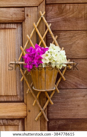 Bougainvillea, white pink potted bamboo stick with old wooden windows which hang beautifully. - stock photo