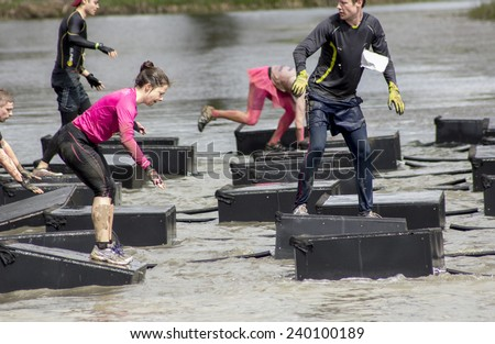 Boughton House Northamptonshire/UK-May 4, 2013: Tough Mudder challenge and obstacle course raising funds for Help for Heroes. - stock photo