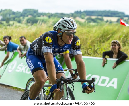 BOUILLE-MENARD,FRANCE- JUL 4: The German cyclist Marcel Kittel of Dimension Data Team rides in front of spectators during the stage 3 of Tour de France in Bouille-Menard on July 4, 2016.