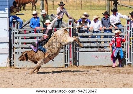 BOULDER - AUGUST 27th: unidentified cowboy rides in the bareback bull-riding competition at Jefferson County Fair and Rodeo on august 27, 2011 in Boulder, Montana - stock photo