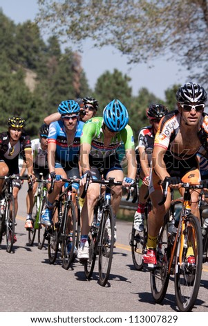 BOULDER, CO - AUGUST 25, 2012:  Cyclists compete in the 2012 USA Pro Cycling Challenge on August 25, 2012 in Boulder, CO - stock photo