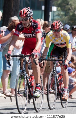 BOULDER, CO - AUGUST 25:  Retiring professional cyclist George Hincapie rides in front of BMC team mate Tejay Van Garderen on August 25, 2012 in Boulder, CO. - stock photo