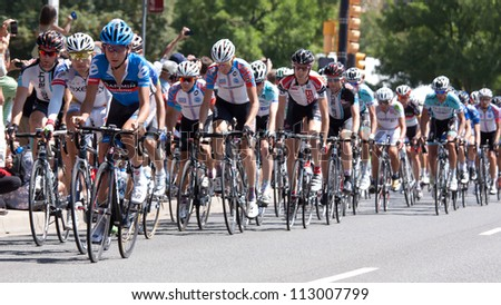 BOULDER, CO - AUGUST 25, 2012:  The peleton racing through downtown in the 2012 USA Pro Cycling Challenge on August 25, 2012 in Boulder, CO - stock photo