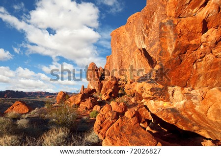 Boulders eroded from a sandstone cliff - Valley of Fire State Park, Nevada. - stock photo