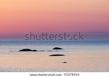 Boulders in the sea. Sunrise in early morning
