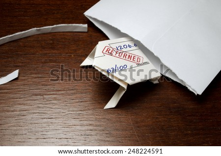 Bounced check folded into origami frog