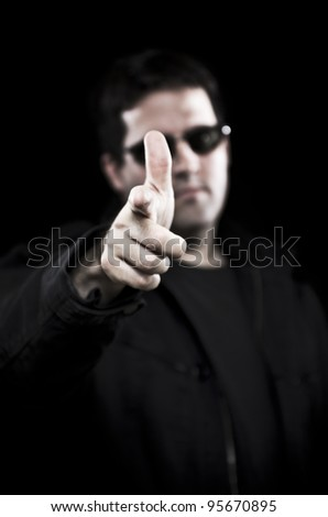 Bouncer points the finger - stock photo