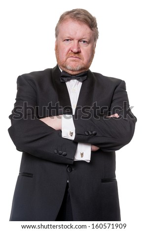 Bouncer with arms folded blocks the way - isolated on white - stock photo