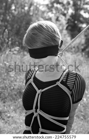 Bound woman with a noose around his neck. Shibari. - stock photo