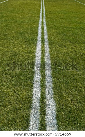Boundary lines of a green playing field.