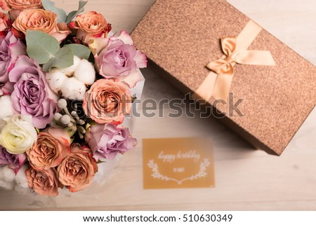 Bouquet and gift box in golden tone