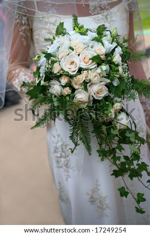 Bouquet flowers in the hands bride - stock photo