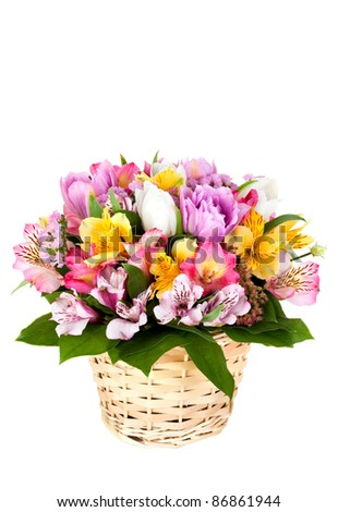 Bouquet from different bright colors in a basket on a white background - stock photo