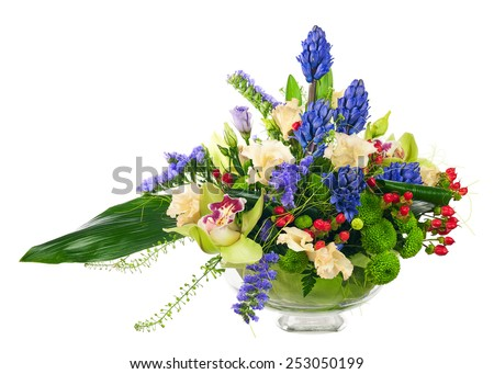 Bouquet from orchids and other flowers in glass vase isolated on white background. Closeup. - stock photo