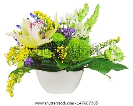 Bouquet from orchids in white vase isolated on white background. Closeup. - stock photo