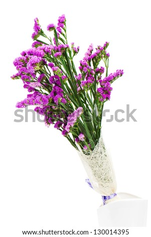 Bouquet from purple statice flowers arrangement centerpiece in vase isolated on white background. - stock photo