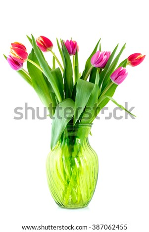 Bouquet from tulips in glass vase isolated on white background