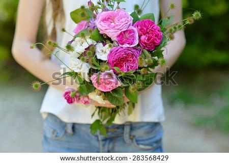 Bouquet in hands. - stock photo