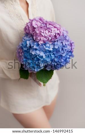 Bouquet in the hands of girl. Hydrangea flower - stock photo