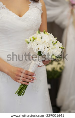 bouquet in the hands of the bride.