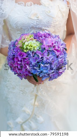 Bouquet in the hands of the bride. Hydrangea flower - stock photo