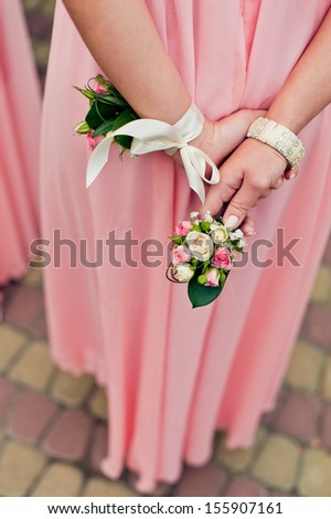 bouquet in the hands of the bridesmaid. - stock photo