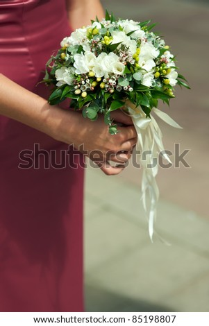 bouquet in the hands of the bridesmaid - stock photo