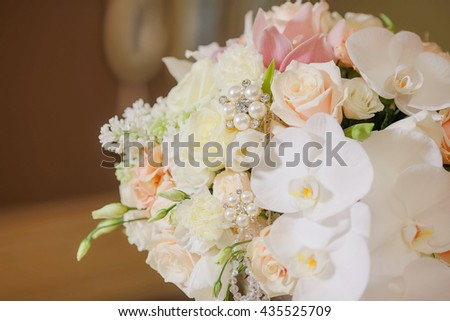 Bouquet made of flowers in pastel tones and decorated with pearls