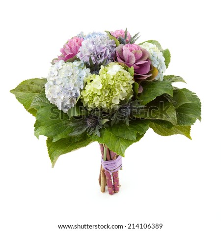 Bouquet made of Hydrangea, Brassica and Eryngium flowers isolated on white. - stock photo